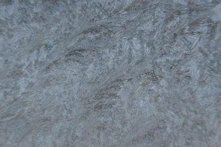 Ice texture background. Frozen window on a winter night. Banco de Imagens