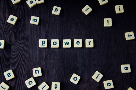 Word or phrase POWER made with letters on the wood, great image for your design.