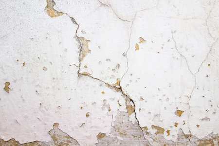 Composition with concrete cement wall with crack in industrial building, Will be good for your design and texture background. Old grunge cracked wall for background