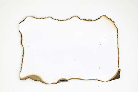 Burned photo paper on white background. Paper element can be used in design