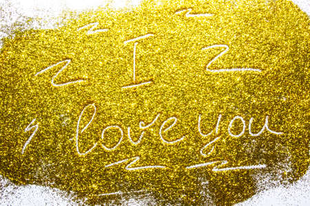 a composition with written a words i love you on beautiful gold glitter. Background and texture of gold glitter. Luxury gold glitter sparkle shining texture background