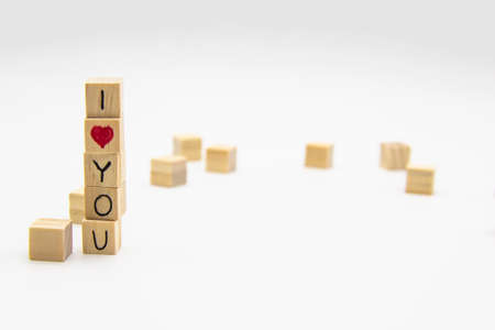 A word I love you written on the wood cubes. I love you lettering made of wooden cubes isolated on white