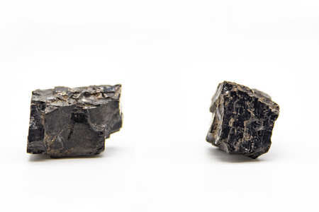 Natural black coals isolated in white background. Two dirty coals stones.