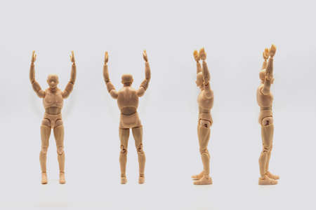 Set of Male dolls mannequin isolated on light background. Mannequin of man shows from four sides and holds hands up Imagens