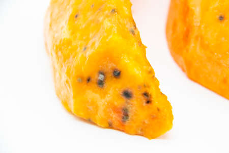 A Rotten pieces of pumpkin. Rotten vegetable and spoiled food. A product that has been affected by mold isolated on the white background.