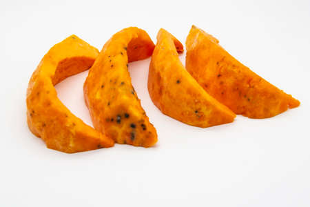 A Rotten pieces of pumpkin. Rotten vegetable and spoiled food. A product that has been affected by mold isolated on the white background. Foto de archivo