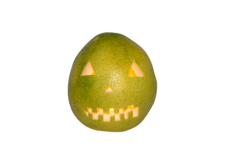 Scary face carved in pomelo fruit with candle inside isolated in white background Imagens