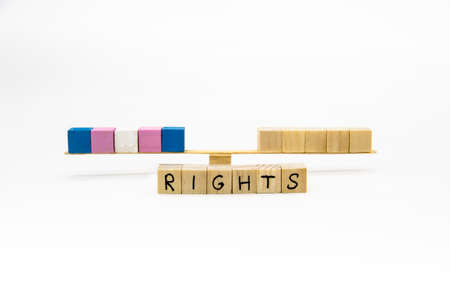 The colors of transgender flag on the wood cubes. Conceptual photo for rights lesbian, gay, bisexual, and transgender