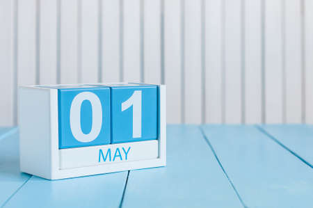may: May 1st. Image of may 1 wooden color calendar on white background.  Spring day, empty space for text.  International Workers Day. Stock Photo