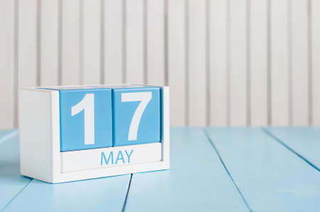 17th: May 17th. Image of may 17 wooden color calendar on white background.  Spring day, empty space for text.  International Day Against Homophobia, IDAHOBIT.