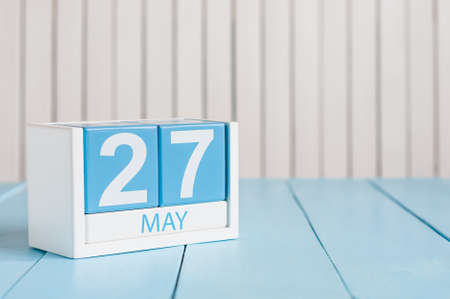 May 27th. Image of may 27 wooden color calendar on white background.  Spring day, empty space for text. European Neighbours Day.