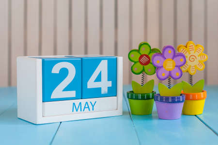 may: May 24th. Image of may 24 wooden color calendar on white background with flowers. Spring day, empty space for text. The European Day Of Parks, EDoP.