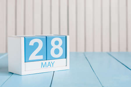 8 years birthday: May 28th. Image of may 28 wooden color calendar on white background.  Spring day, empty space for text.