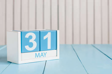 31st: May 31st. Image of may 31 wooden color calendar on white background.  Last spring day, Spring end. Empty space for text. World blondes Day.