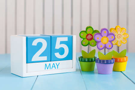 25th: May 25th. Image of may 25 wooden color calendar on white background with flowers. Spring day, empty space for text. International Missing Children Day. World Thyroid DAY.