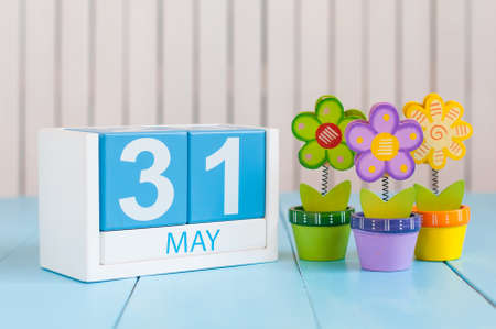 31st: May 31st. Image of may 31 wooden color calendar on white background with flowers. Last spring day, Spring end. Empty space for text. World blondes Day.