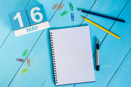 may: May 16th. Image of may 16 wooden color calendar on blue background.  Spring day, empty space for text.  Biographers Day.