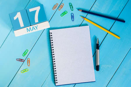 17th: May 17th. Image of may 17 wooden color calendar on blue background.  Spring day, empty space for text.  International Day Against Homophobia, IDAHOBIT. Stock Photo