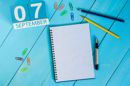 empty space for text: September 7th. Image of september 7 wooden color calendar on white background. Autumn day. Empty space for text.