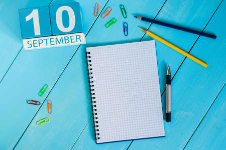 10th: September 10th. Image of september 10 wooden color calendar on white background. Autumn day. Empty space for text. World First Aid Day.