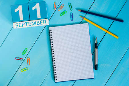 11th: September 11th. Image of september 11 wooden color calendar on white background. Autumn day. Empty space for text.