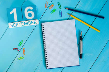 the place is important: September 16th. Image of september 16 wooden color calendar on white background. Autumn day. Empty space for text.