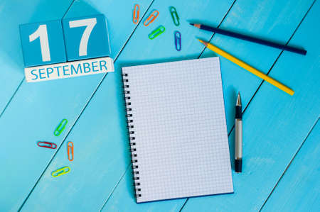 17th: September 17th. Image of september 17 wooden color calendar on white background. Autumn day. Empty space for text.