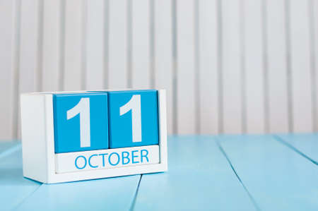 11th: October 11th. Image of October 11 wooden color calendar on white background. Autumn day. Empty space for text.