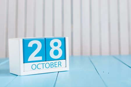 28: October 28th. Image of October 28 wooden color calendar on white background. Autumn day. Empty space for text.