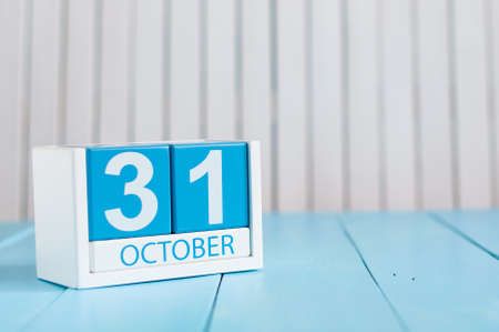 31st: October 31st. Image of October 31 wooden color calendar on white background. Autumn day. Empty space for text.