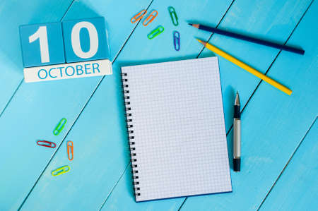 October 10th. Image of October 10 wooden color calendar on blue background. Autumn day. Empty space for text. Stok Fotoğraf
