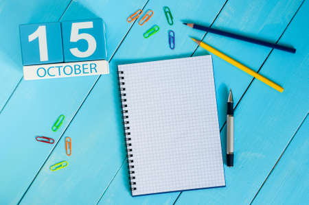 15th: October 15th. Image of October 15 wooden color calendar on blue background. Autumn day. Empty space for text.