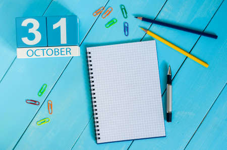 31st: October 31st. Image of October 31 wooden color calendar on blue background. Autumn day. Empty space for text. Stock Photo