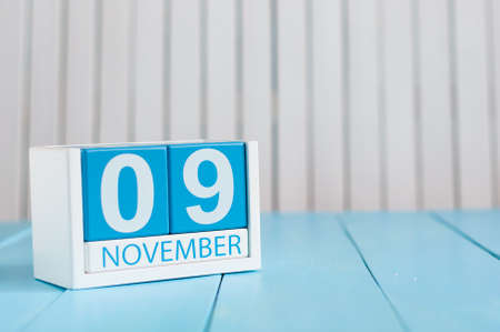 9th: November 9th. Image of november 9 wooden color calendar on blue background. Autumn day. Empty space for text. Stock Photo