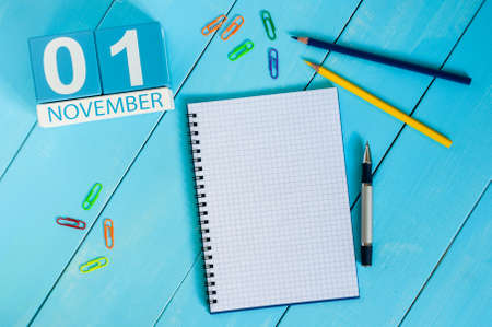 test deadline: November 1st. Image of november 1 wooden color calendar on blue background. Autumn day. Empty space for text.