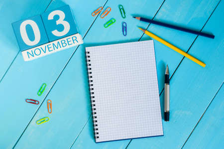 test deadline: November 3rd. Image of november 3 wooden color calendar on blue background. Autumn day. Empty space for text.