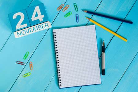 test deadline: November 24th. Image of november 24 wooden color calendar on blue background. Autumn day. Empty space for text. Stock Photo