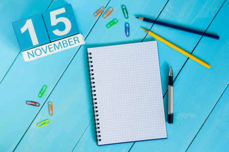 15th: November 15th. Image of november 15 wooden color calendar on blue background. Autumn day. Empty space for text.