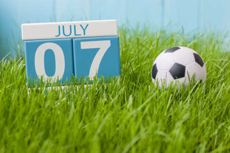 greengrass: July 7th. Image of july 7 wooden color calendar on greengrass lawn background. Summer day, empty space for text. Stock Photo