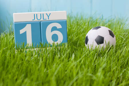 greengrass: July 16th. Image of july 16 wooden color calendar on greengrass lawn background. Summer day, empty space for text. Stock Photo