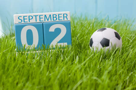 September 2nd. Image of september 2 color calendar on green grass lawn background. Autumn day. Empty space for text.