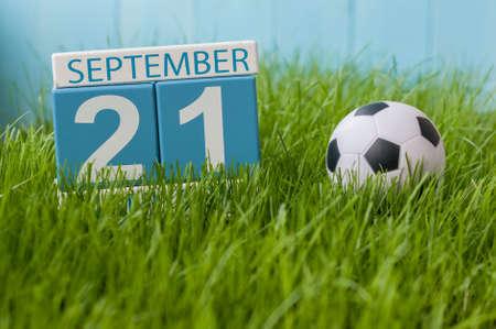 September 21st. Image of september 21 wooden color calendar on green grass lawn background. Reklamní fotografie