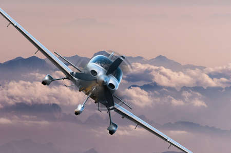 Private light airplane or aircraft fly on mountain background. Stok Fotoğraf