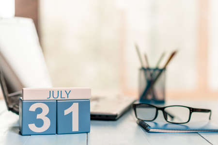 31st: July 31st. Day 31 of month wooden color calendar on business office background. Stock Photo