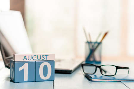 10th: August 10th. Day 10 of month, wooden color calendar on office background. Stock Photo