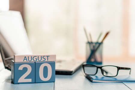 20th: August 20th. Day 20 of month, wooden color calendar on business background.