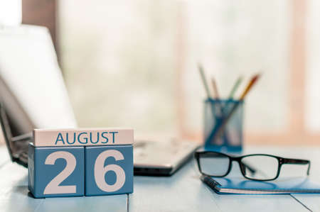 26th: August 26th. Day 26 of month, wooden color calendar on traveler workplace background. Stock Photo