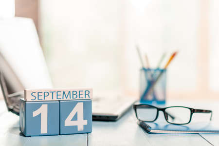fourteenth: September 14th. Day 14 of month, calendar on auditor workplace background. Stock Photo