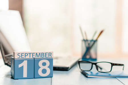 analyst: September 18th. Day 18 of month, calendar on analyst workplace background. Stock Photo