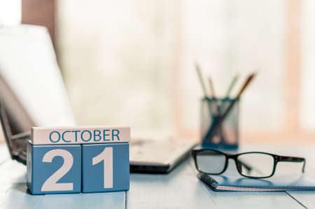 October 21st. Day 21 of month, calendar on teacher table background.